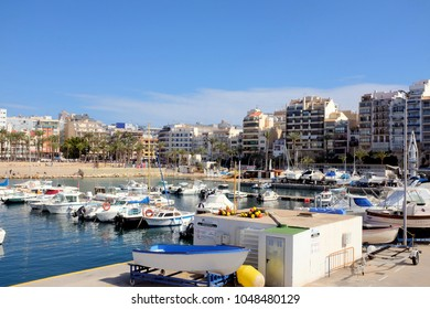 Benidorm, Spain.  March 10, 2018. The tourist attraction of the marina and port with pleasure and working boats and yachts at Playa de Poniente in Benidorm on the costa Blanca in Spain.