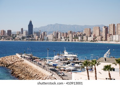 BENIDORM, SPAIN - NOVEMBER 4: Crowed beaches of Benidorm November 4, 2010 in Benidorm, Spain. Crowed beaches with a lot of tourists with a lot of hotels on the background