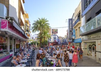 Benidorm, Spain-july 10. 2017: People walking on the shopping street in Benidorm, Alicante, Spain.