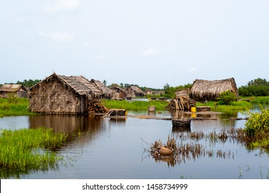benin river above houses and village
