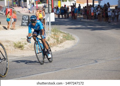 Benissa Alicante Spain on August 25, 2019: Peloton cycling the second stage of La Vuelta Benidorm to Calpe in Benissa coast, the winner was Nairo Quintana is in the image