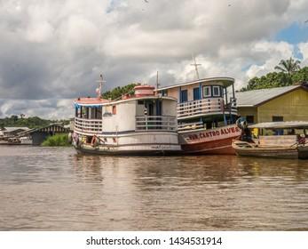 Benjamin Constant, Brazil - May 10, 2016: Boat in  the port of Amazon river. South America. Amazon River.  Tres fronteras. Rain Forest of Amazonia.