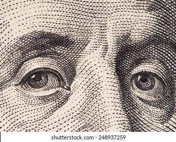 Benjamin Franklin eyes extreme macro on us 100 dollar bill, united states money closeup