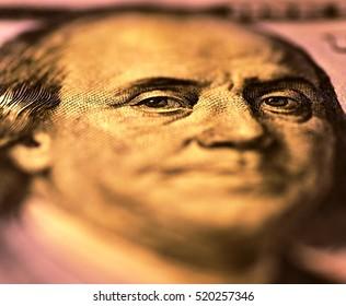 Benjamin Franklin. Eyes in focus on obverse of the 100 US dollar bill