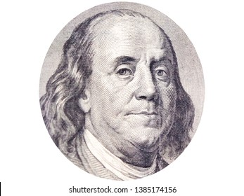 Benjamin Franklin face in ellipse on 100 dollar bill o white background.