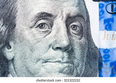 Benjamin Franklin face macro on us 100 dollar bill, united states money closeup