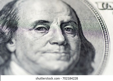 Benjamin Franklin with notes of 100 dollars. Macro composition