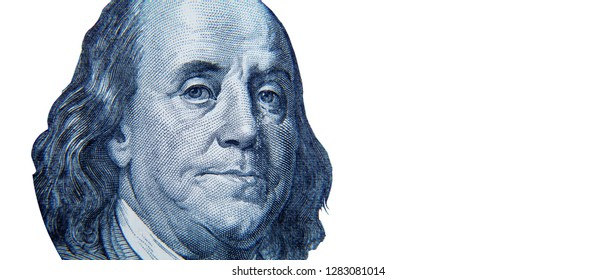 Benjamin Franklin on one hundred US Dollar bill. Money of United States. Macro image isolated on white background. Business and finance concept.