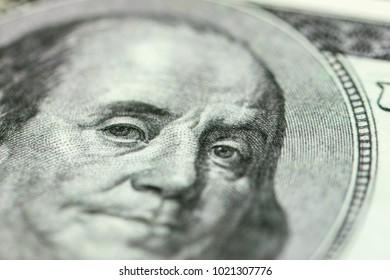Benjamin Franklin portrait close-up on 100 dollars banknote