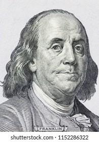 Benjamin Franklin portrait on new one hundred US dollars banknote. Vertical close up portrait.