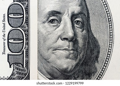 Benjamin Franklin's eyes from a hundred-dollar bill. The eyes of Benjamin Franklin on the hundred dollar banknote, backgrounds, close-up. 100 dollar bill with only eyes of Benjamin Franklin