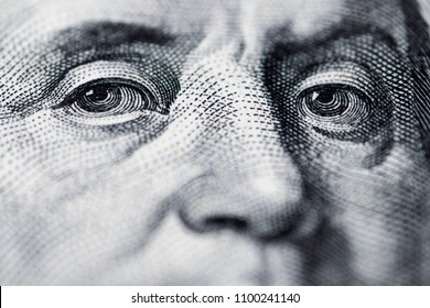 Benjamin Franklin's look on a hundred dollar bill. Benjamin Franklin portrait macro usa dollar banknote or bill