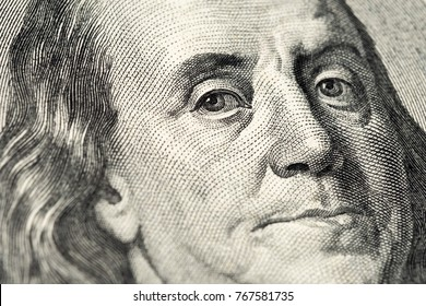 Benjamin Franklin's portrait on one hundred (100) american dollar bill. Macro close up view.