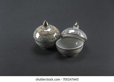 Benjarong casket ceramic gold on Black background