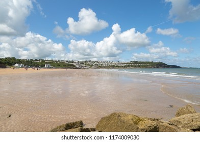 BENLLECH, ANGLESEY - August 25th, 2018: View of people enjoying Benllech beach at low tide