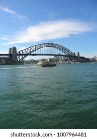 BENNELONG POINT, SYDNEY, AUSTRALIA - 21 JANUARY 2018 - Sydney Harbour Bridge, with ferry in the foreground.
