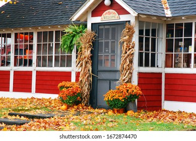 Bennington, VT, USA October 15,  Fall decorations and fallen leaves are outside a café in Bennington, Vermont