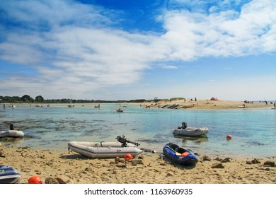 BENODET, FRANCE - August, 19, 2018: Boats at the Letty Beach and La Mer Blanche « White sea » - preserved natural lagoon between Benodet et Mousterlin, Brittany, Finistere, France