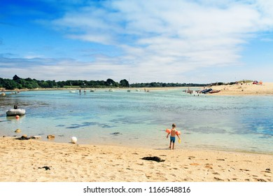 BENODET, FRANCE - August, 19, 2018: Little boy at Letty Beach and La Mer Blanche « White sea » - preserved natural lagoon between Benodet et Mousterlin, Brittany, Finistere, France