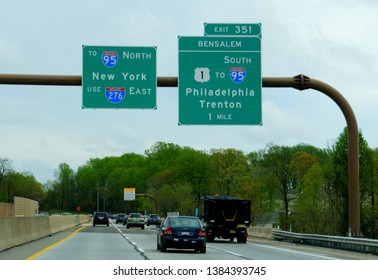 Bensalem, Pennsylvania, U.S.A - April 26, 2019 - Traffic on the highway with road signs to Interstate 95 North, 95 South and 276 East