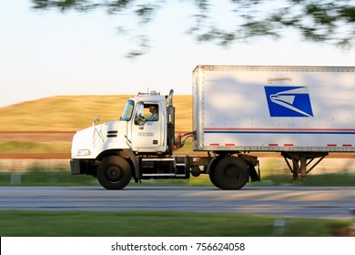 BENSENVILLE, ILLINOIS / USA - June 20, 2017: United States Postal Service truck on the road in the suburbs of Chicago transporting packages.