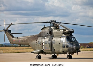 BENSON, ENGLAND - AUGUST 25: Puma helicopter waits to be pulled back into its hanger having completed a troop drop demonstration at the Benson airshow on August 25, 2011 in Benson.