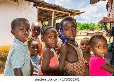 Bensonville City, Liberia - April 9, 2019: Curious sweet children outside the village palaver hut