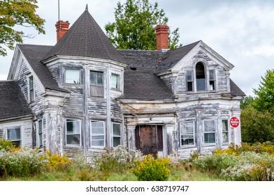 bent and Broken Abandoned Home