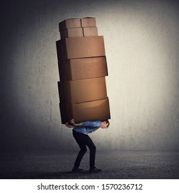 Bent down guy carrying a lot of big heavy boxes on his back. Overloaded of daily tasks, and difficult burden. Packing stuff and moving concept. Mail worker package delivery before christmas holidays.