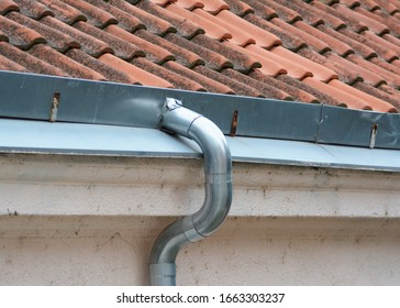 a bent gutter on a house