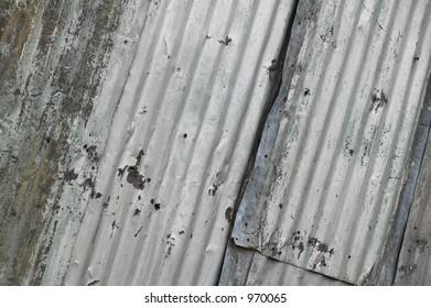 bent and worn corrugated metal