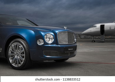 Bentley Mulsanne and Bombardier private jet on the airfield of Pulkovo airport, Saint-Petersburg, Russia 09.10.2016