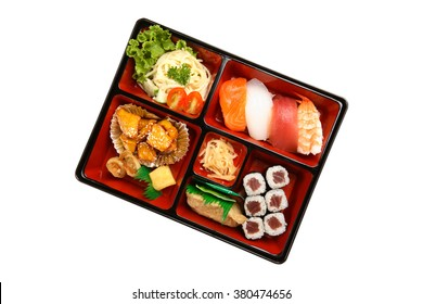 Bento box set with sushi isolated on white background, top view