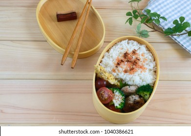 Bento is a Japanese takeaway lunch served in a box, often with the food arranged into an elaborate design. A traditional bento holds rice or noodles, fish or meat, with pickled and cooked vegetables.