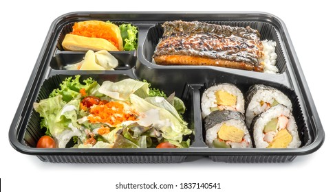 Bento set, Japanese meal in a Box isolated on white background - grilled unagi or eel with rice, salad, sushi and sweet egg roll stuffed with salmon's eggs.