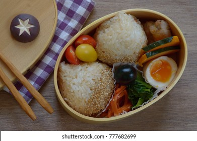 Bento is a single-portion take-out or home-packed meal common in Japanese cuisine. A traditional version holds rice or noodles, fish or meat, with pickled and cooked vegetables, in a box