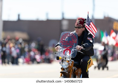 Benton Harbor, Michigan, USA - May 4, 2019: Blossomtime Festival Grand Floral Parade, Saladin Shriners members riding mini motorcycles during the parade