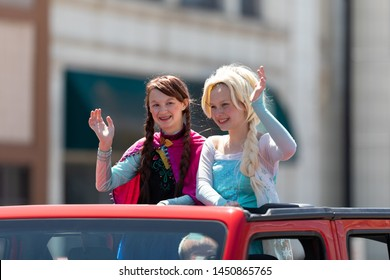 Benton Harbor, Michigan, USA - May 4, 2019: Blossomtime Festival Grand Floral Parade, Girls dress up as frozen characters Anna and Elsa