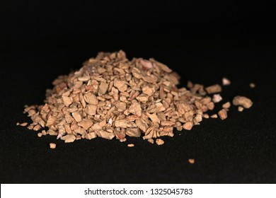 Bentonite clay desiccant pile on a black background