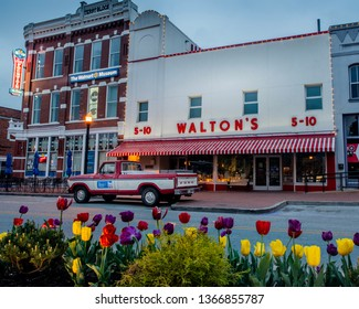 Bentonville, AR—April 11, 2019; old red and white ford truck that belonged to Sam Walton parked in front of first Walmart store which now serves as a corporate museum near the Arkansas headquarters