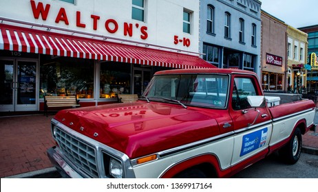 Bentonville, AR—April 11, 2019; Red and White pickup truck that belonged to Sam Walton, founder of walmart parked in front of his first five and dime store which now serves as a corporate museum