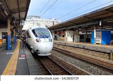 Beppu, Japan - November 30, 2014 : The Limited Express Kamome arriving at platform. There are plenty of trains running throughout Kyushu. JR Kyushu train.
