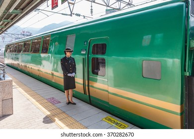 "BEPPU,JAPAN - MAY 29: Tourist train called ""Yufuin no mori(Forest of Yufuin city)"" at Beppu station on MAY 29 2014 in Beppu city, Japan. It is the most popular tourist train in Japan."