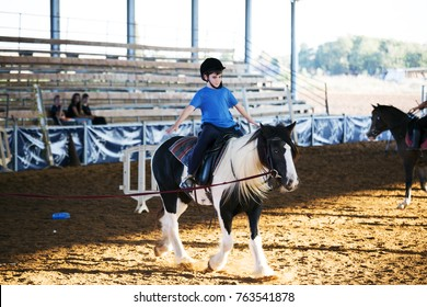 Ber Yakov, Israel - September 28, 2016: Horse riding lessons for kids. The boy on the horse