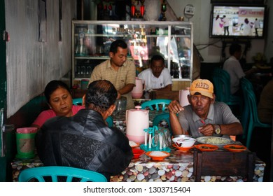 Berastagi, Sumatra - January 26, 2018: a group of Indonesian friends eat at a local eatery