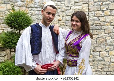 BERAT, ALBANIA - APRIL 5, 2017: Young Albanian couple in national costumes, in Berat, Albania.