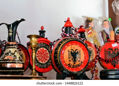Berat, Albania - June 12 2019: Albanian souvenirs for sale at a tourist site in Berat. Items on the typical albanian street stall selling tourist souvenirs