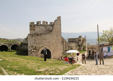 BERAT, ALBANIA-APR. 7, 2016:  Tourists at the entrance to the UNESCO World Heritage Site at Berat, an old fortified city with historical churches and mosques.
