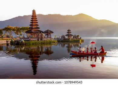 Beratan Lake in Bali Indonesia, apirl 26 2018 : Balinese villagers participating in traditional religious Hindu procession in Ulun Danu temple Beratan Lake in Bali Indonesia