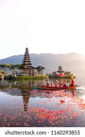 Beratan Lake in Bali Indonesia, Aug 16 2018 : Balinese villagers participating in traditional religious Hindu procession in Ulun Danu temple Beratan Lake in Bali Indonesia